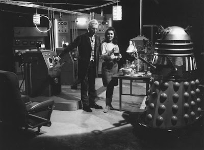 31st January 1966:  Peter Cushing (1913-1994) as Dr Who and Jill Curzon as his niece, Louise, with a dalek on the set of, 'Daleks: Invasion Earth 2150 AD' directed by Gordon Flemyng.  (Photo by McCabe/Express/Getty Images)