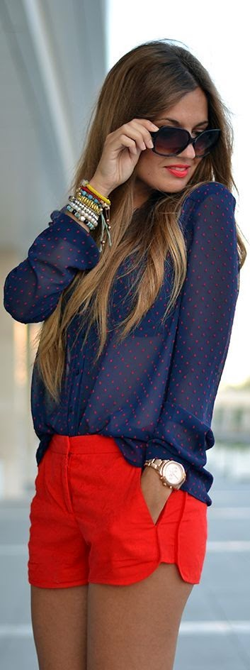 Red Shorts With Spotted Blue Blouse