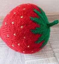 http://www.ravelry.com/patterns/library/giant-strawberry
