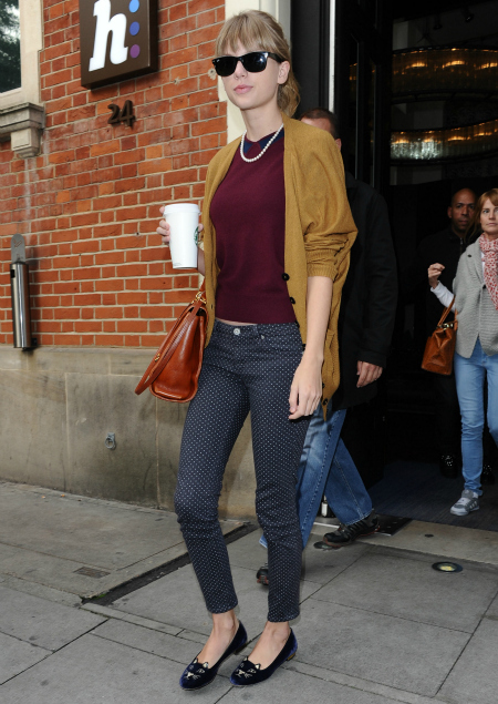 Taylor Swift polka dot jeans, yellow cardigan, cat shoes