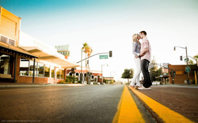 Romantic couple falling in love on the town and street