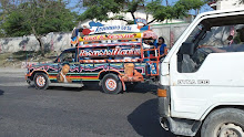 Cite Soleil, Haiti 2011: One of the many vehicles decorated and painted with Slogans