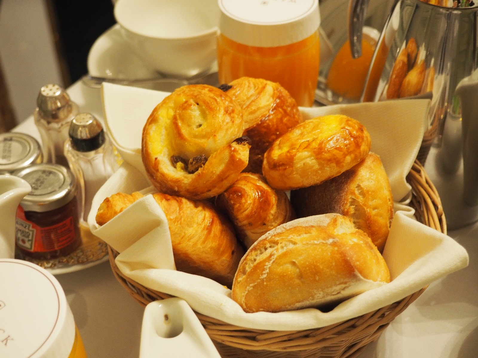 Basket of patisserie on white table cloth