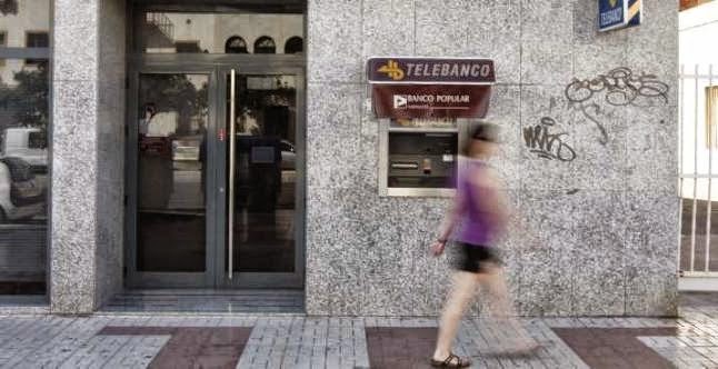 M laga la roja cuatro entidades bancarias controlan casi for Oficinas la caixa santander