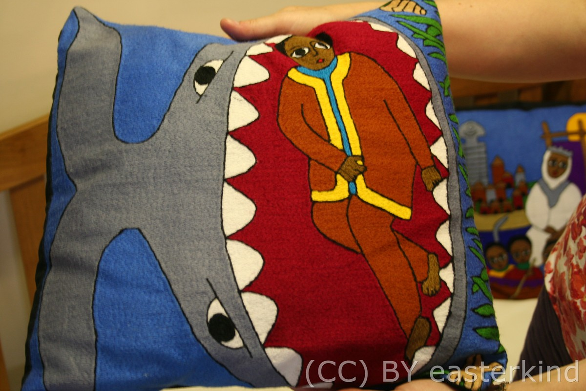 pillow cover: a whale with a huge, gaping mouth showing Jonah inside