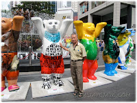 John posing with some of the United Buddy Bears at Pavilion KL