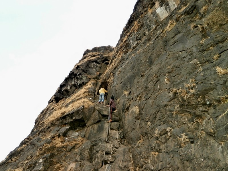 Our local guides do a free climb of the 25 feet rock patch on Alang