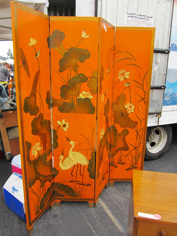 Orange lacquer painted wood screen with crane landscape