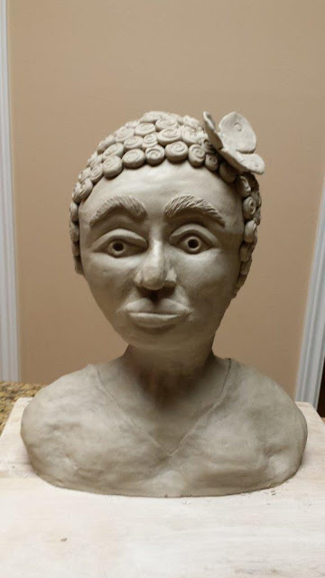Ceramic pottery sculptural bust of negro woman, in progress.