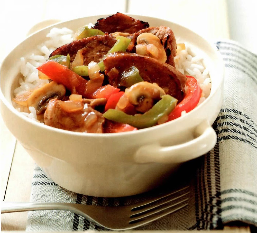Marinated Pork with Pepper: Dish of marinated pork cooked in a vegetable stock base with bell peppers... Shown served in a bowl on a bed of rice.