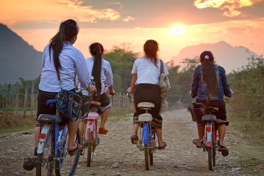 'after school ride' • near vang vieng, laos    © marc montebello all rights reserved