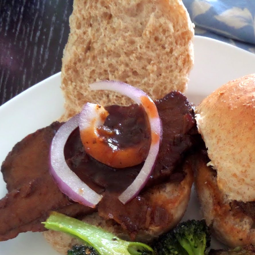 Guinness Barbecue Brisket Sliders:  Tender smoked brisket smothered in a Guinness barbecue sauce on yeast roll slider buns.