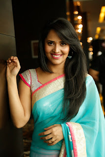 Anasuya Lovely TV Anchor Sizzling Pics in Backless Choli and Lovely Light Blue Saree WOW