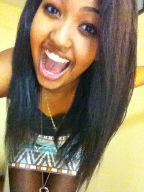 Soliyana's natural flat-ironed hair