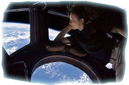 Self portrait of Tracy Caldwell Dyson in the Cupola module of the International Space Station observing the Earth below during Expedition 24. Photo by Tracy Caldwell Dyson