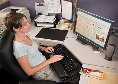 woman at computer, with ergonomic set-up