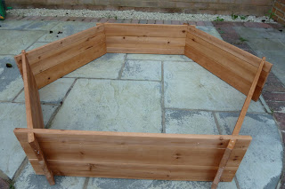 Hexagonal wooden sandpit
