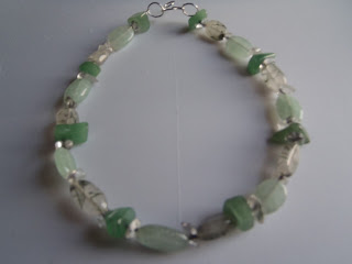 https://www.etsy.com/listing/124685893/rare-green-rutilated-quartz-green