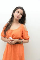 Madhurima Hot Orange Dress Stylish Photos