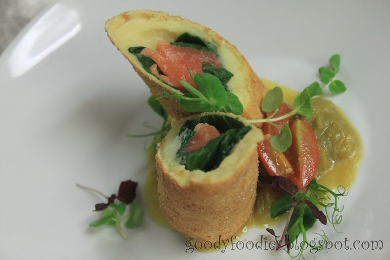 Salmon roll with spinach and potato, served with a leek and tomato ...