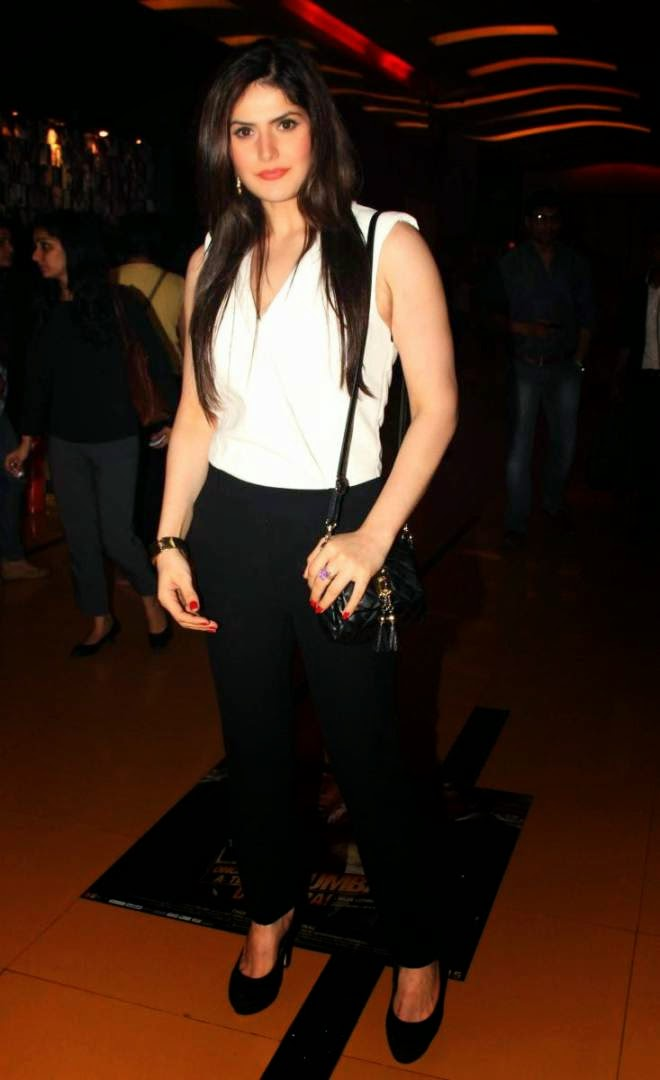 zarine khan looking hot white top and black pant pics