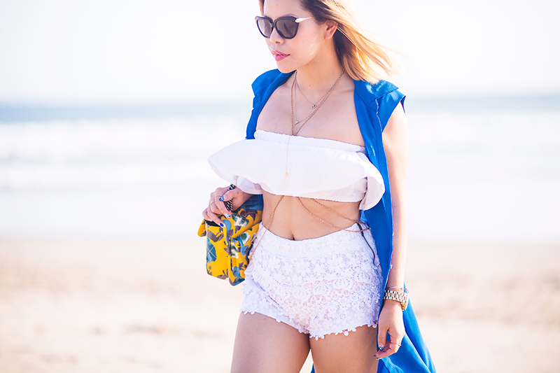 Crystal Phuong in ruffle crop top, white lace shorts, and blue kimono in Bali