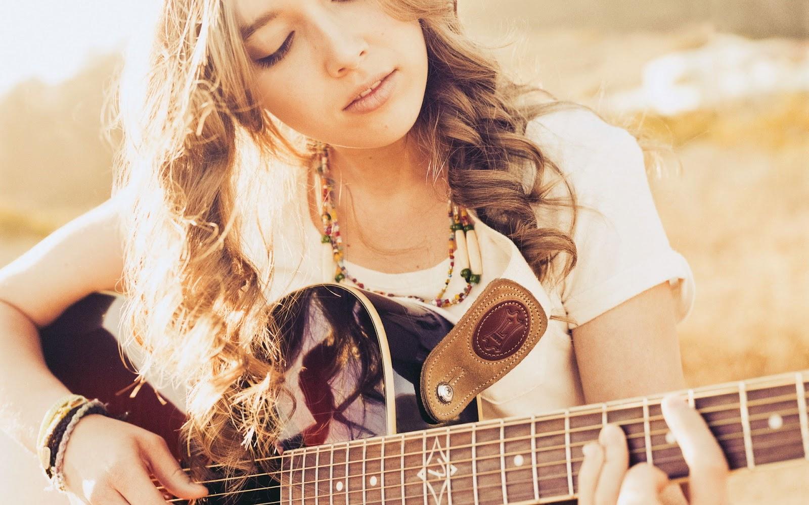 http://1.bp.blogspot.com/-sXIfKMj_xw4/UHHSCY_5NkI/AAAAAAAAFaU/8cPi8pIsw0o/s1600/girl_with_guitar_2_hd_widescreen_wallpapers_1920x1200.jpeg