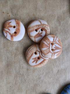 Four cream Polymer clay buttons with brown printed design