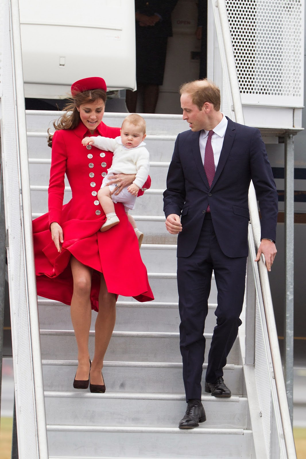 WINDY HAZARD: Kate struggled to cope with the wind with one hand while holding Prince George in her arm when she arrived in New Zealand.