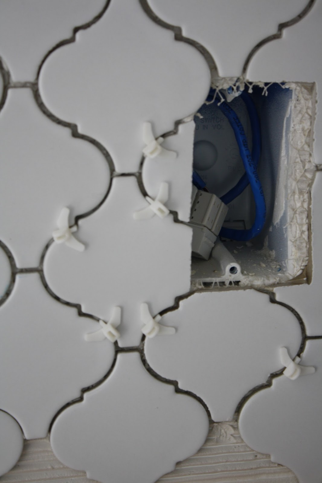 how to get tile adhesive off the back of tiles