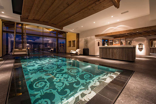 Picture of large indoor swimming pool with the swing