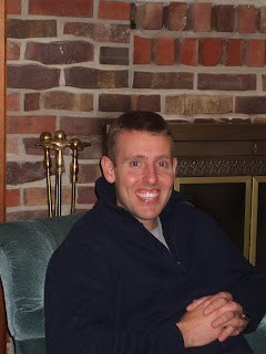 Matthew Horn sitting in front of fireplace