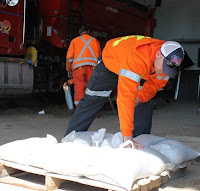 image two Kawartha Lakes firefighters filling sandbags