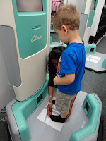 Big Boy Having His Feet Measured At Clarks
