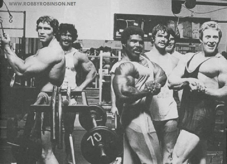 "Robby Robinson, Arnold Schwarzenegger, Ed Corney, Ken Waller, Denny Gable a.a. during Training and Filming of Pumping Iron at Gold's Gym Venice, CA 1975 - Read about RR's training and life  experience, about other legends of Golden Era of bodybuilding  and what really happened behind the scenes of Weider's empire  - in RR's BOOK ""The BLACK PRINCE; My Life in Bodybuilding:  Muscle vs. Hustle"" - ▶ www.robbyrobinson.net/books.php"