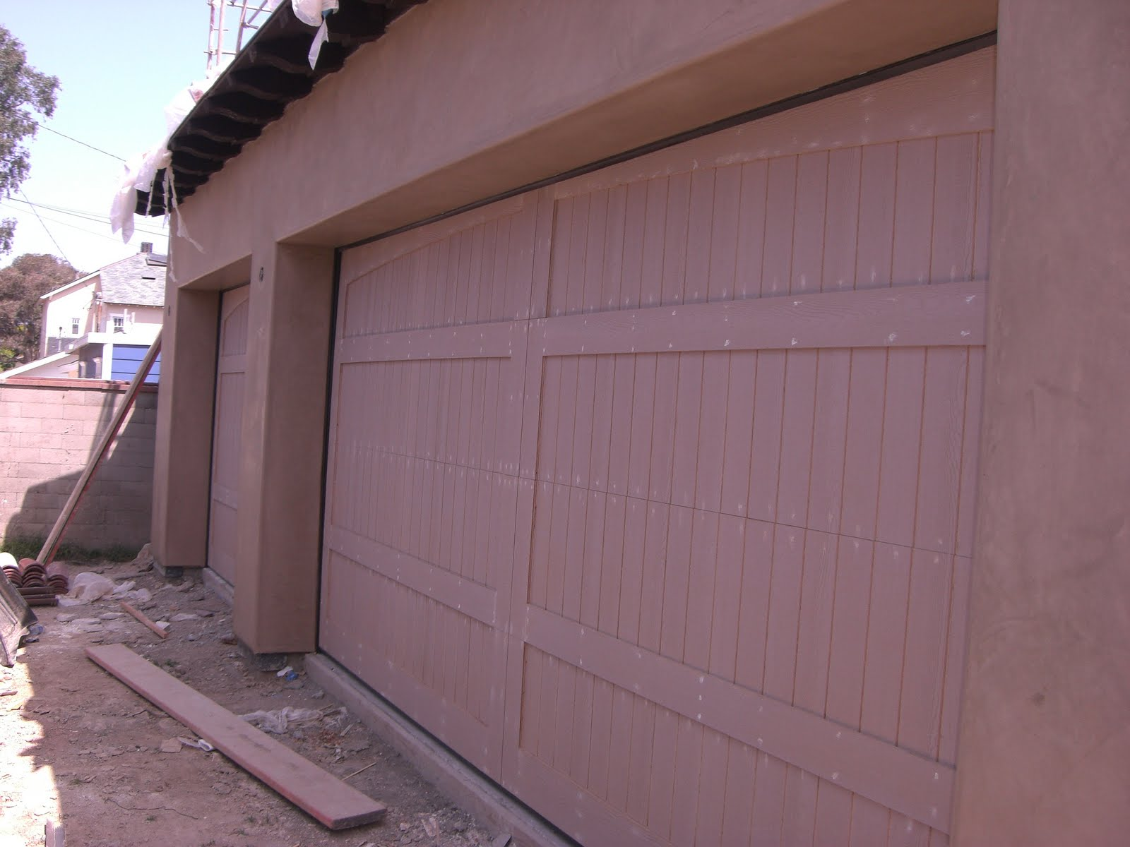 1200 #1D2BAE Garage Doors Just Installed. They Will Be Stained A Dark Brown Color  wallpaper Dark Wood Garage Doors 36951600