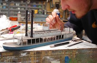 Man building model ship