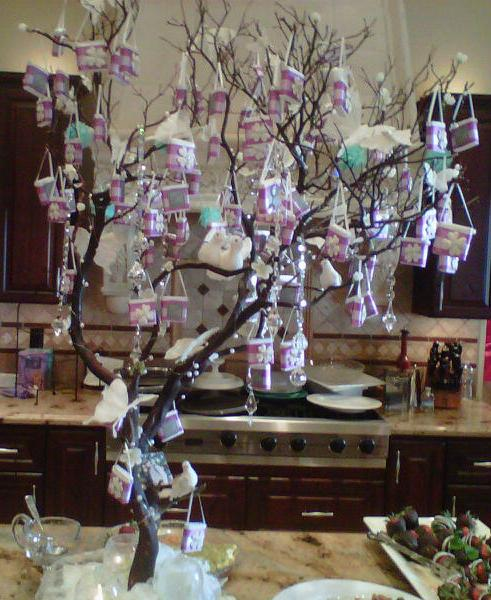 we then placed each hand bag favor on a decorative tree display that matches the theme and style the favors one of the greatest things was that they loved