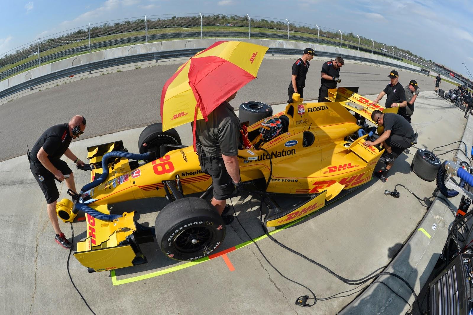 Ryan Hunter-Reay receiving service in pit lane.