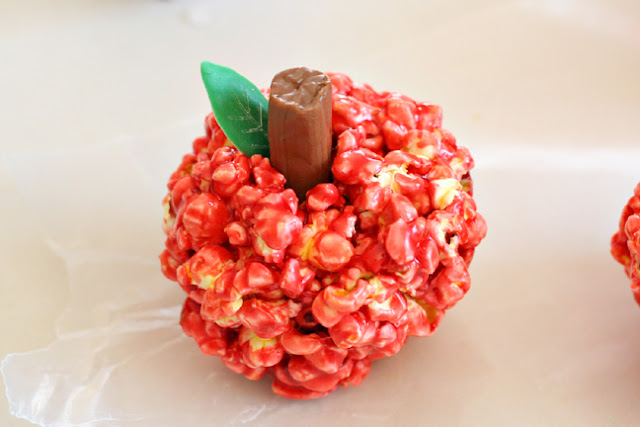 cute apple treat made from popcorn ball
