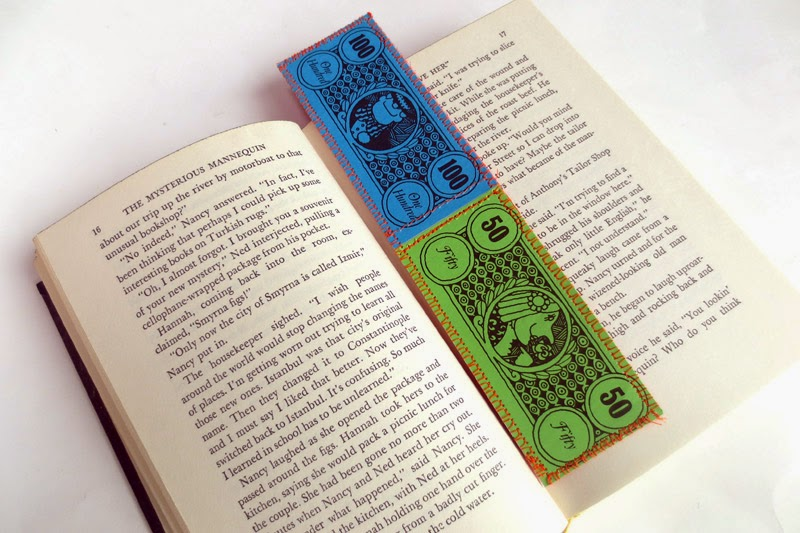 making an upcycled bookmark out of play money