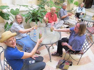 "Joan, Margie, Julian, Ted, Dianne & Sarah enjoying a ""welcome"" mojito"