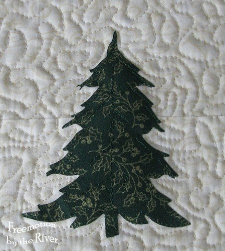 closeup of Evergreen trees table runner at Freemotion by the River