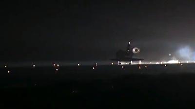 Endeavour landing, open parachute. NASA 2011.