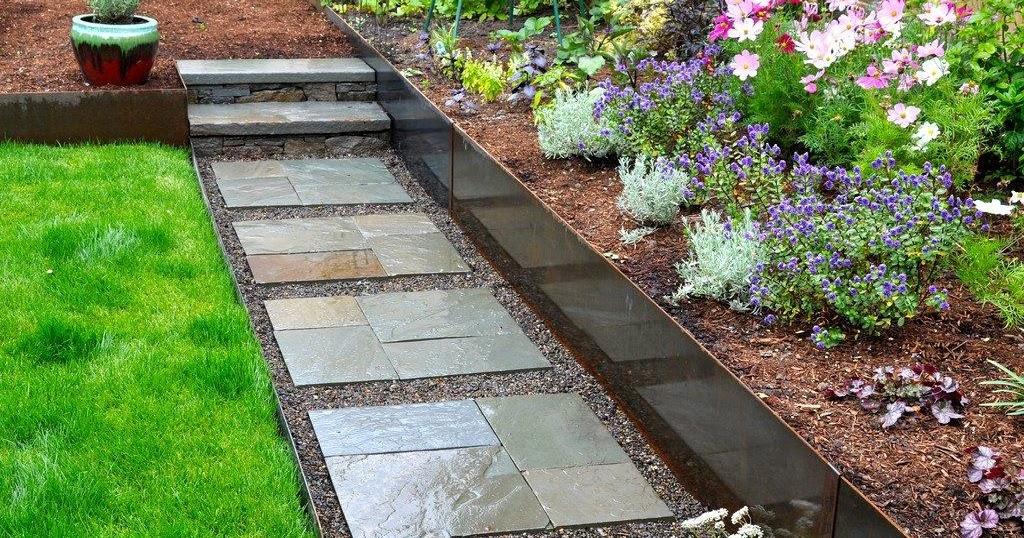 Limestone patio with blue flowers wild dalliance for Jardines decorados con piedras