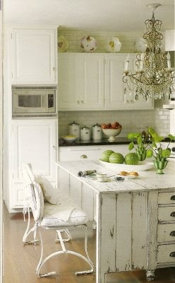 mylittlehousedesign.com shabby chic kitchen with plates above cabinets
