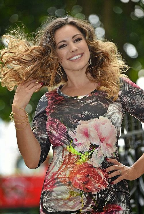The 34-year-old brightening their collection in a truth character of floral artistic short dress garment while combining those pose with a grey high heels for the camera snap shots on Wednesday, September 3, 2014.