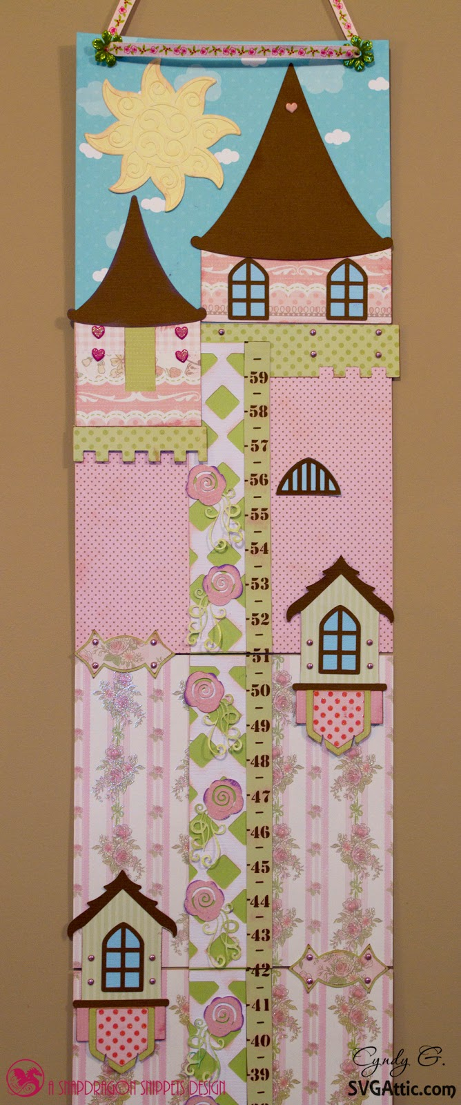 A child's growth chart for a girl.  Princess castle with rose vine ruler.