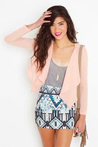 Chic peach chiffon crop jacket featuring a draped collar and asymmetric hem.