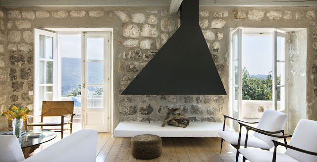 living room minimalist decor croatian croatia home coastline coast villa interior exposed limestone walls white furniture home furnishings